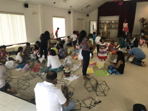 On Sunday 13th, a group of children and adults is making vesak lanterns.